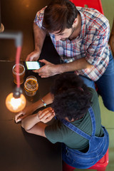 Couple on friends talking in a beer bar