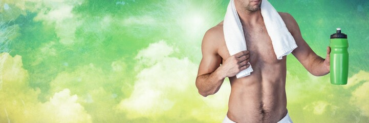 Fit strong Man with green background holding flask drink