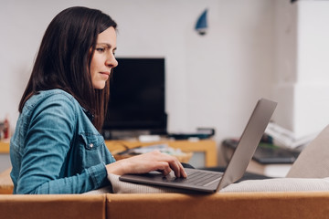 Young woman working on a laptop computer