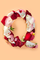 Letter Q made from red roses and petals isolated on a white background