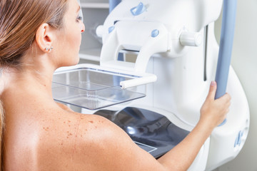 Woman undergoing medical mammography scan