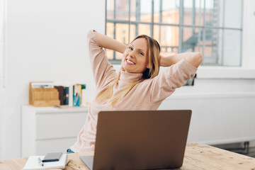 Happy successful businesswoman relaxing