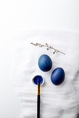 Eggs painted blue color on Easter holiday. White background, copy space