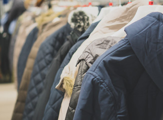 Collection of winter jackets in clothing store.