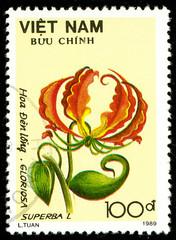 Ukraine - circa 2018: A postage stamp printed in Vietnam shows flower Gloriosa superbal. Series: Flowers. Circa 1989.