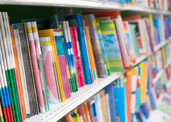 School notebooks on shelf in bookstore.