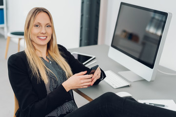 Happy successful businesswoman with her feet up