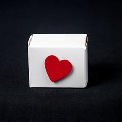 Red rose in white paper box ,Valentine concept.