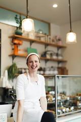 Portrait of female entrepreneur sitting in restaurant