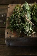 Fresh Rosemary and thyme on wood crate