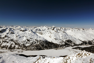 A amazing view of snow covered landscape, mountains and a town in St Moritz Switzerland in the alps