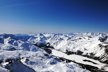 An amazing view of snow covered landscape, mountains and a town in St Moritz Switzerland in the alps