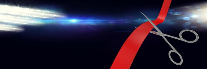 Scissors cutting ribbon with bright lights