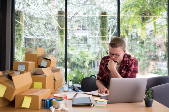 frustrated startup small business owner working at workplace. stressed freelance man seller check product order for delivery.  Online selling, e-commerce, shipping concept