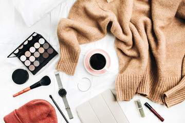 Female fashion look with stylish clothes and accessories. Lifestyle flat lay, top view composition with sweater, cosmetics and coffee. Wall mural