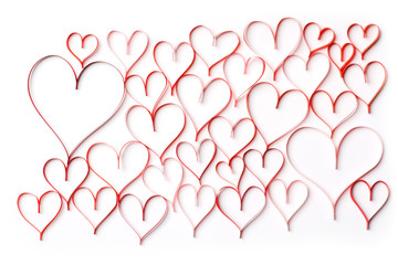 Abstract background of red contours of hearts on a white background. Concept on Valentine day or wedding.