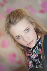 Portrait of young blonde woman with floral scarf looking at cameraåÊ