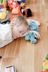 Young boy playing with toys on floor