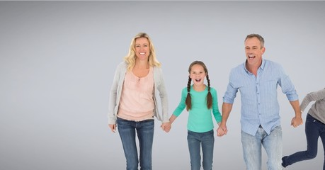 Family together holding hands with grey background