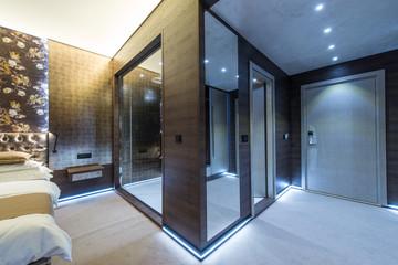 Modern shower cabin in bedroom, luxury interior