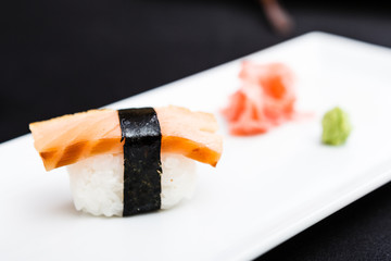 Smoked salmon sushi served on a plate