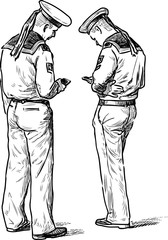 Two sailors stand with their mobile phones