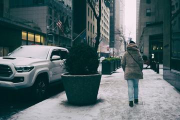 girl walking on famous new york avenue.