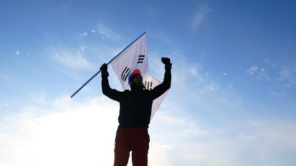 Male fan with South Korean flag rejoices and supports athletes