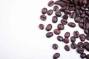 Background of of coffee beans on white background. Isolated.