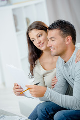 couple looking at finances in home office together