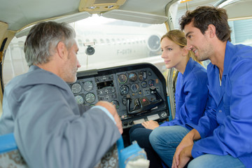 instructor teaching how to pilot a plane