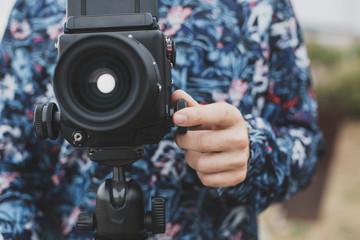 Crop man with medium format film camera
