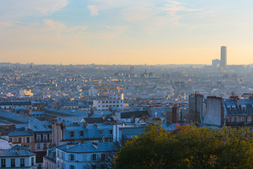 Evening panoramic cityscape downtown of Paris in backlit sunbeam. View from the Basilica of Sacre-Coeur.