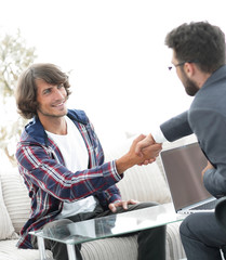 manager shakes hands with his client