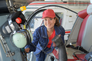 happy woman ready to go in helicopter