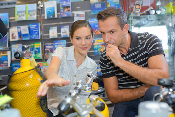 Man and lady looking at fishing equipment