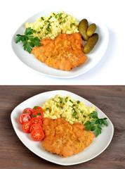 kotlet schabowy z ziemniakami,ogórkiem i pomidorem