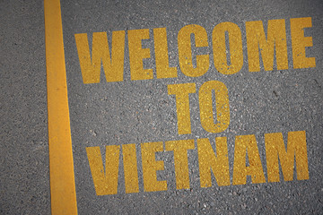asphalt road with text welcome to vietnam near yellow line. concept
