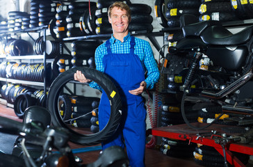 Man standing with auto tires