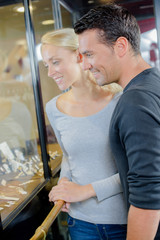 young couple enjoys shopping in jewellery store