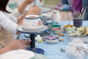 painting ceramics - children painting ceramic dishes