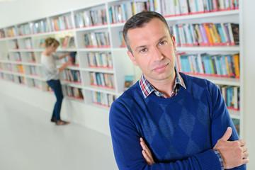 bookshop with man posing