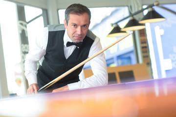 man playing pool