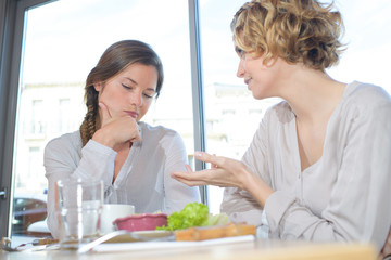 Women chatting over lunch