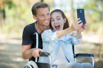 young pretty girl taking a selfie with a man