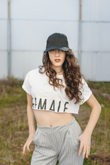 Portrait of young woman wearing a baseball cap in an abandoned building