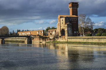 """Arno River and Citadel. """"Cittadella"""" (Citadel) of Pisa is an ancient fortification where was the ancient Republic Arsenal. Guelph Tower (XV century). Pisa, Tuscany, Italy, Europe."""