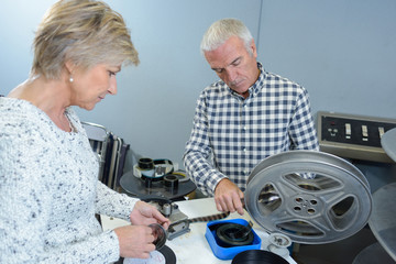 elderly couple with home film reels