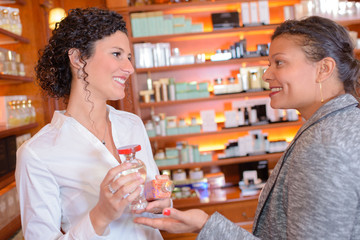 Two women in perfume shop