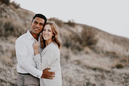 Happy mixed-race millennial couple